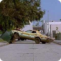 the gran torino smashes into the dumpster